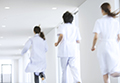 Doctors and nurses running down a hallway