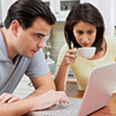 Image of couple at laptop