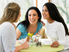 Photo of women talking in a cafe
